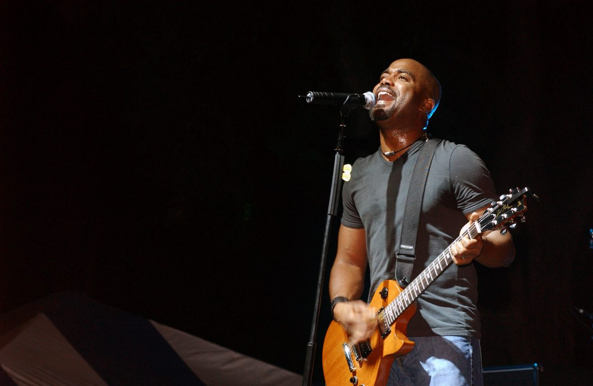 Hootie and the Blowfish lead singer Darius Rucker performs one of his many hit songs along with his band, during a free concert sponsored by the Air Force Reserve Command (AFRCOM) at Hickam Air Force Base (AFB), Hawaii (HI).